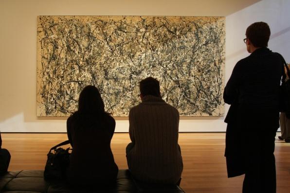 People-looking-at-paintings